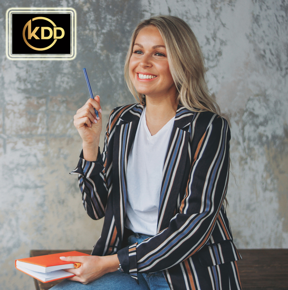 Beautiful smiling blonde young woman businesswoman with pen and planner in casual clothing in loft modern office